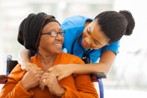 young doctor with an elderly patient at the nursing home
